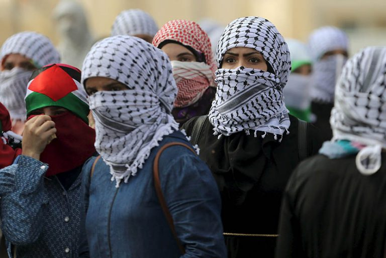 Female Palestinian protesters take position during clashes with Israeli troops near the Jewish settlement of Bet El, near the West Bank city of Ramallah October 10, 2015. Eleven days of bloodshed in which four Israelis and 19 Palestinians have been killed in Jerusalem, the Israeli-occupied West Bank, Gaza and in Israeli cities have raised concerns about a new Palestinian uprising. REUTERS/Mohamad Torokman